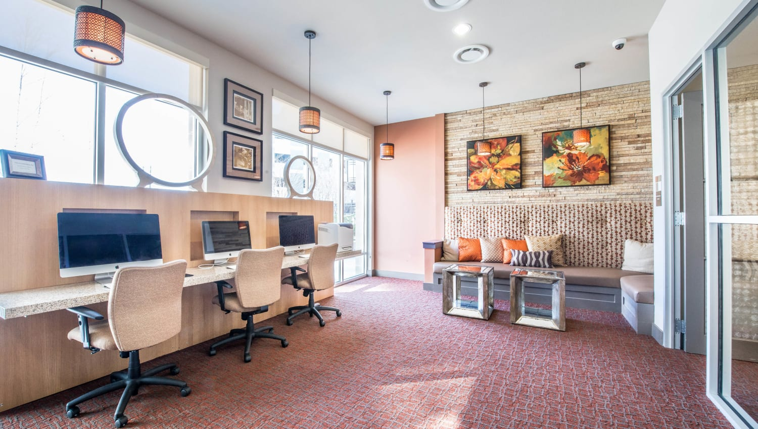 Computer workstations for resident use in the business center at Union At Carrollton Square in Carrollton, Texas
