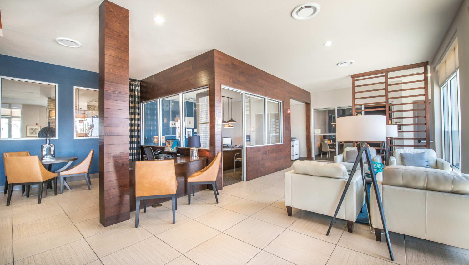 Leasing area with a nearby lounge in the lobby at Union At Carrollton Square in Carrollton, Texas