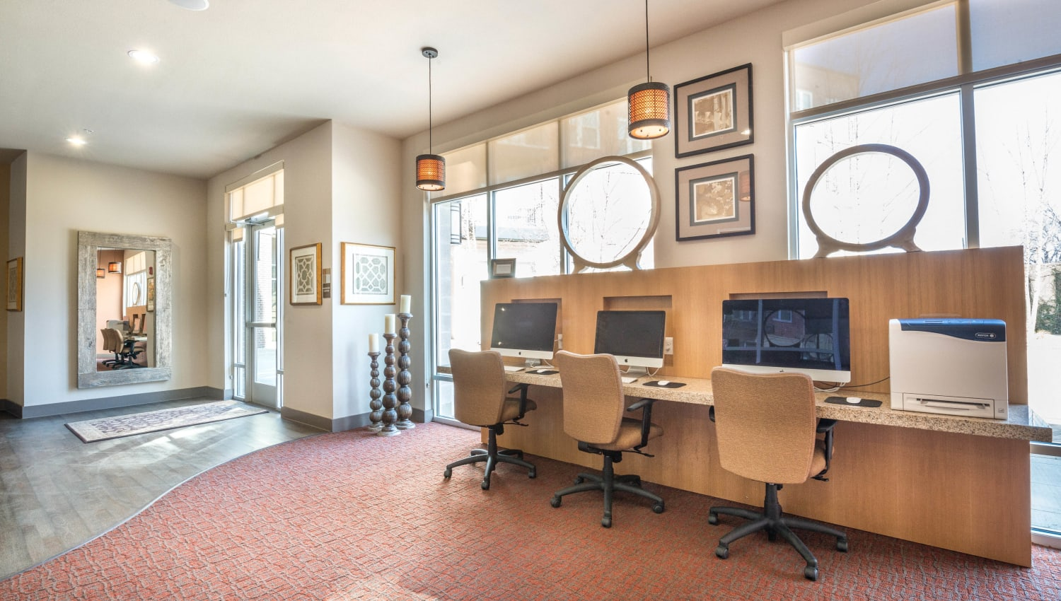Plenty of room and equipment to get work done in the business center at Union At Carrollton Square in Carrollton, Texas