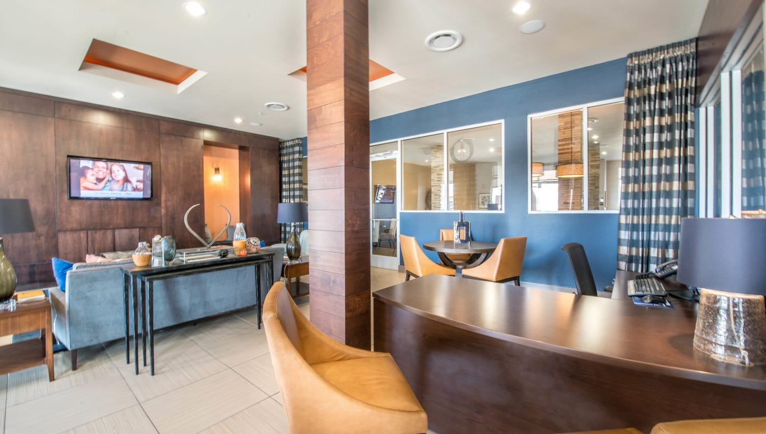 Meeting areas in the clubhouse lounge at Union At Carrollton Square in Carrollton, Texas
