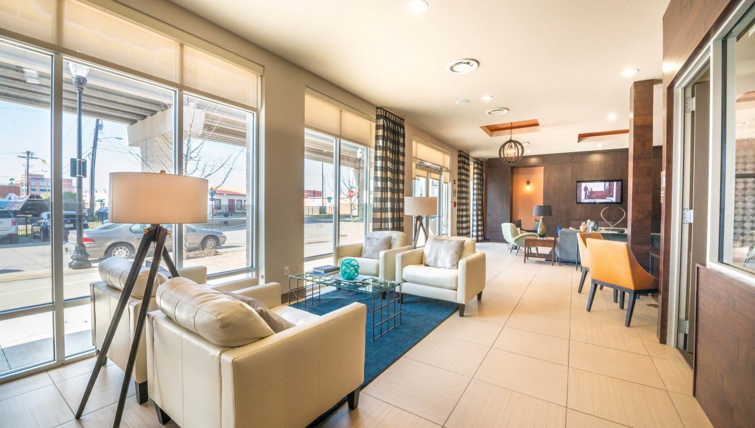 Modern furnishings in the lobby at Union At Carrollton Square in Carrollton, Texas