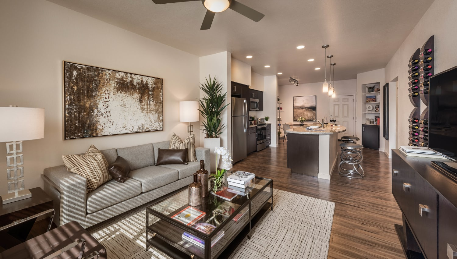 Ceiling fan and hardwood floors in a model home's living area at Vistara at SanTan Village in Gilbert, Arizona