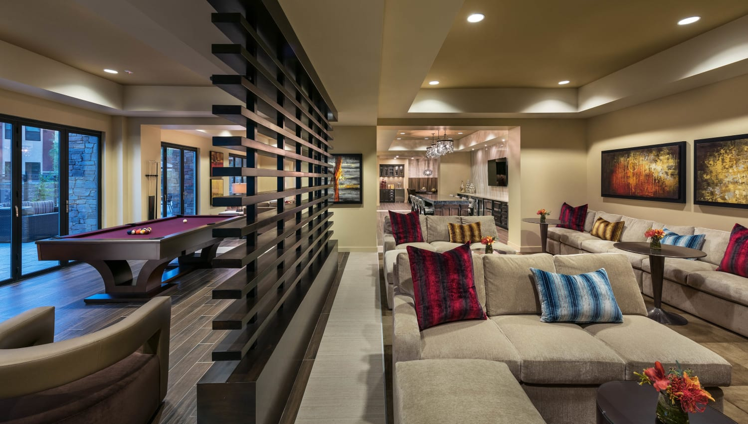 Lounge area near the billiards table in the clubhouse game room at Vistara at SanTan Village in Gilbert, Arizona