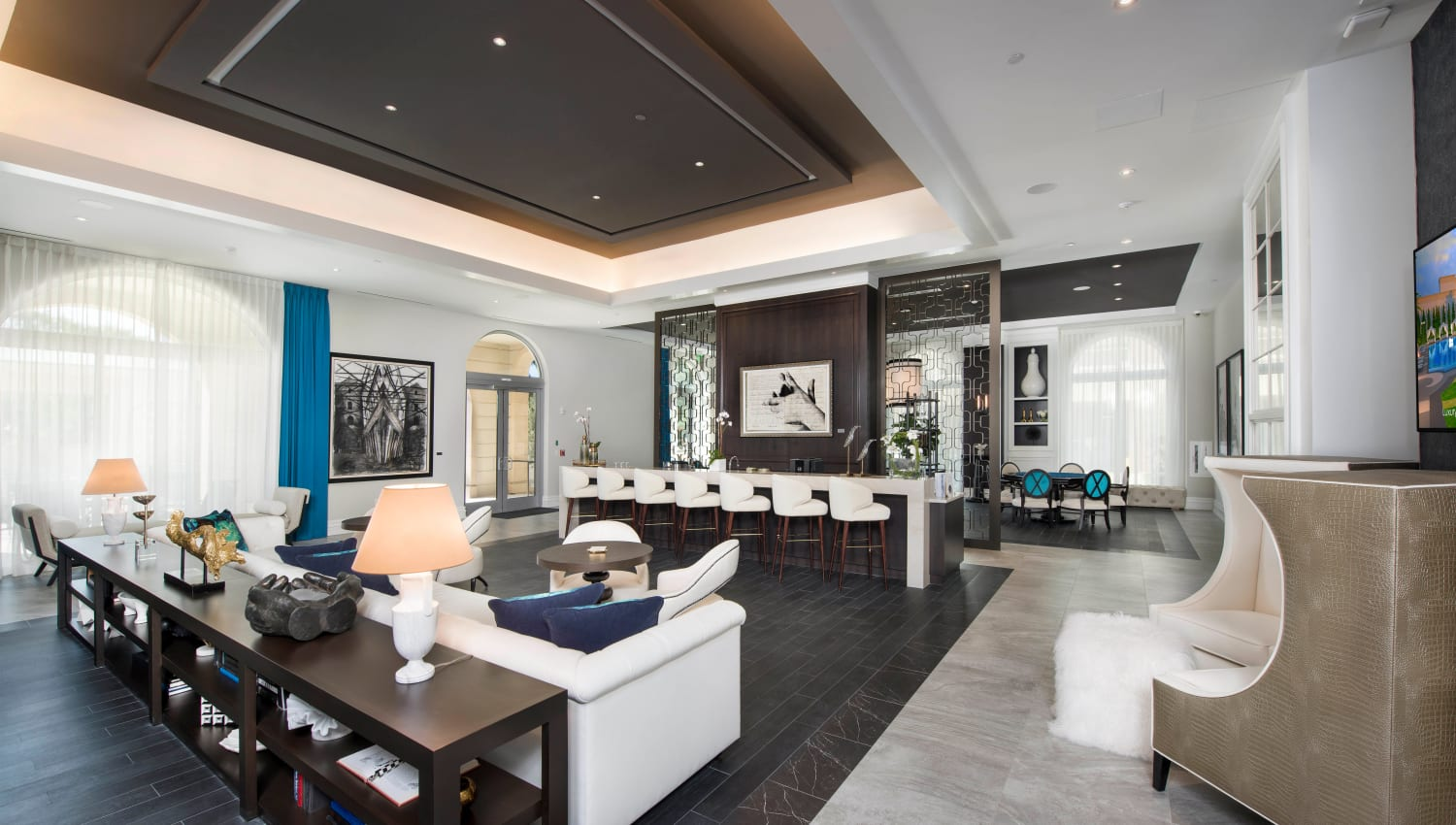 Modern furnishings and art adorn the clubhouse bar at Olympus Harbour Island in Tampa, Florida