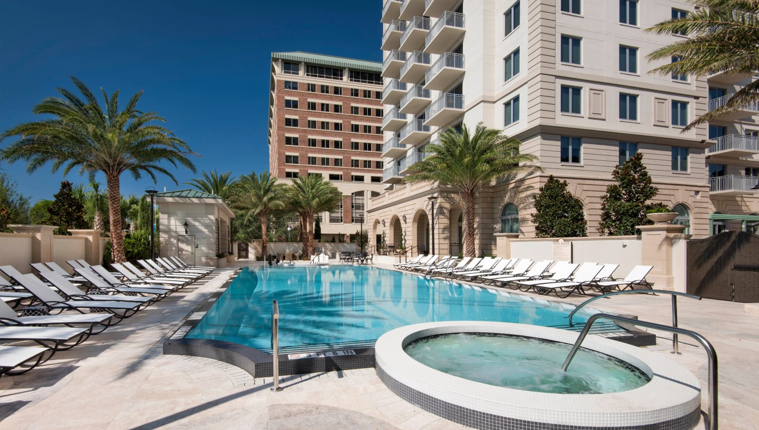 Resort-style swimming pool and spa at Olympus Harbour Island in Tampa, Florida
