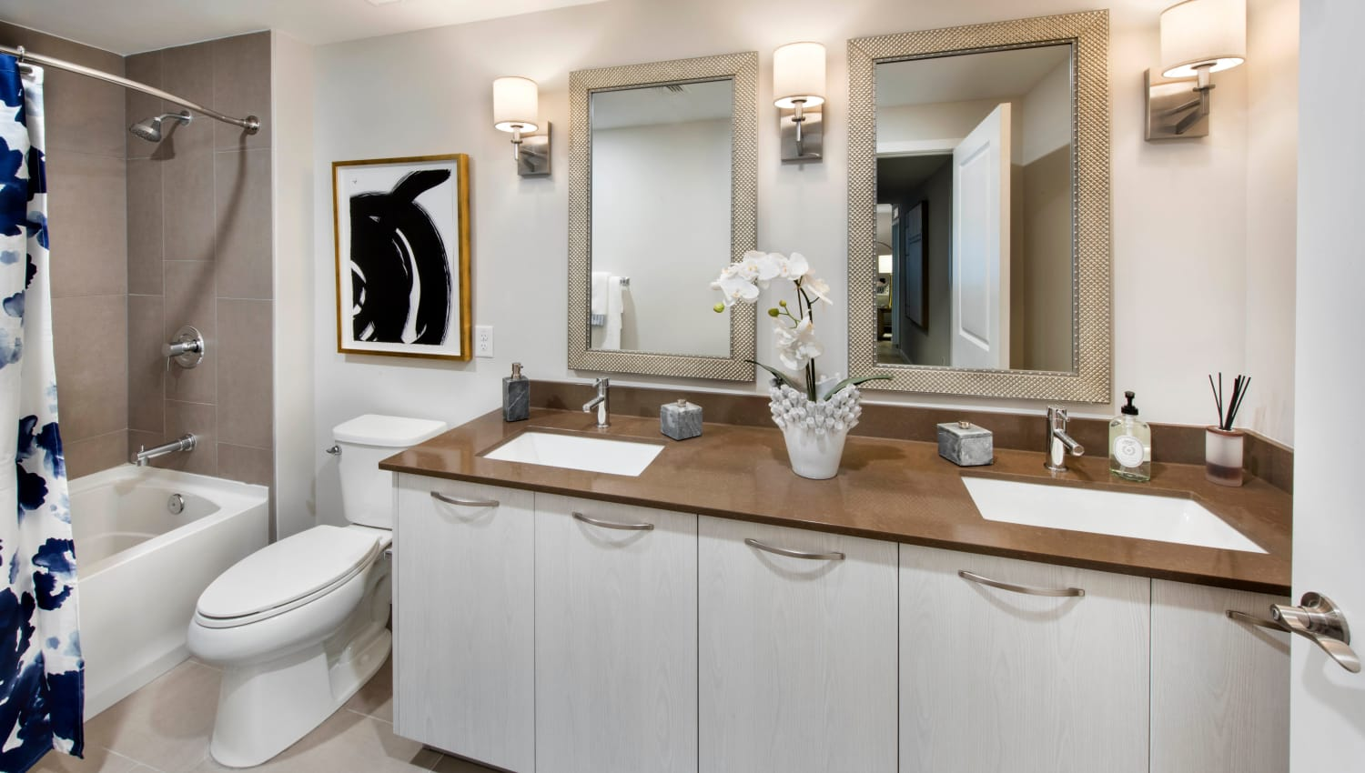 Dual sinks in a model home's bathroom at Olympus Harbour Island in Tampa, Florida