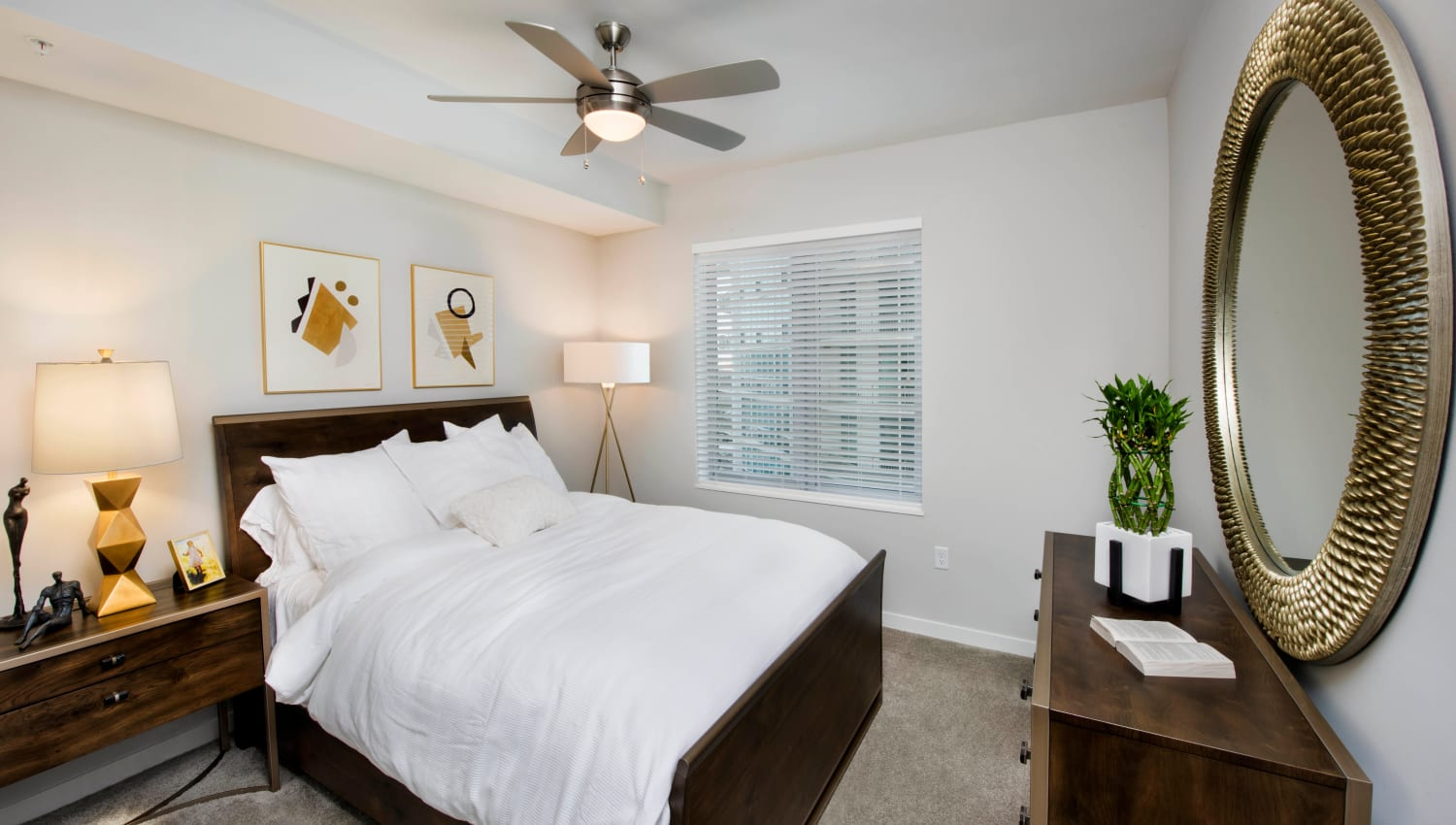 Ceiling fan and modern furnishings in a luxury model home's master bedroom at Olympus Harbour Island in Tampa, Florida