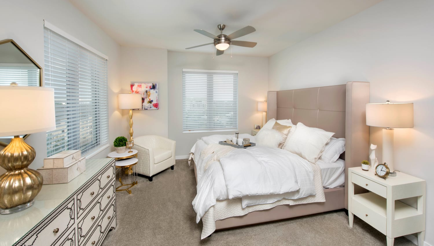 Ceiling fan and plush carpeting in a model home's bedroom at Olympus Harbour Island in Tampa, Florida