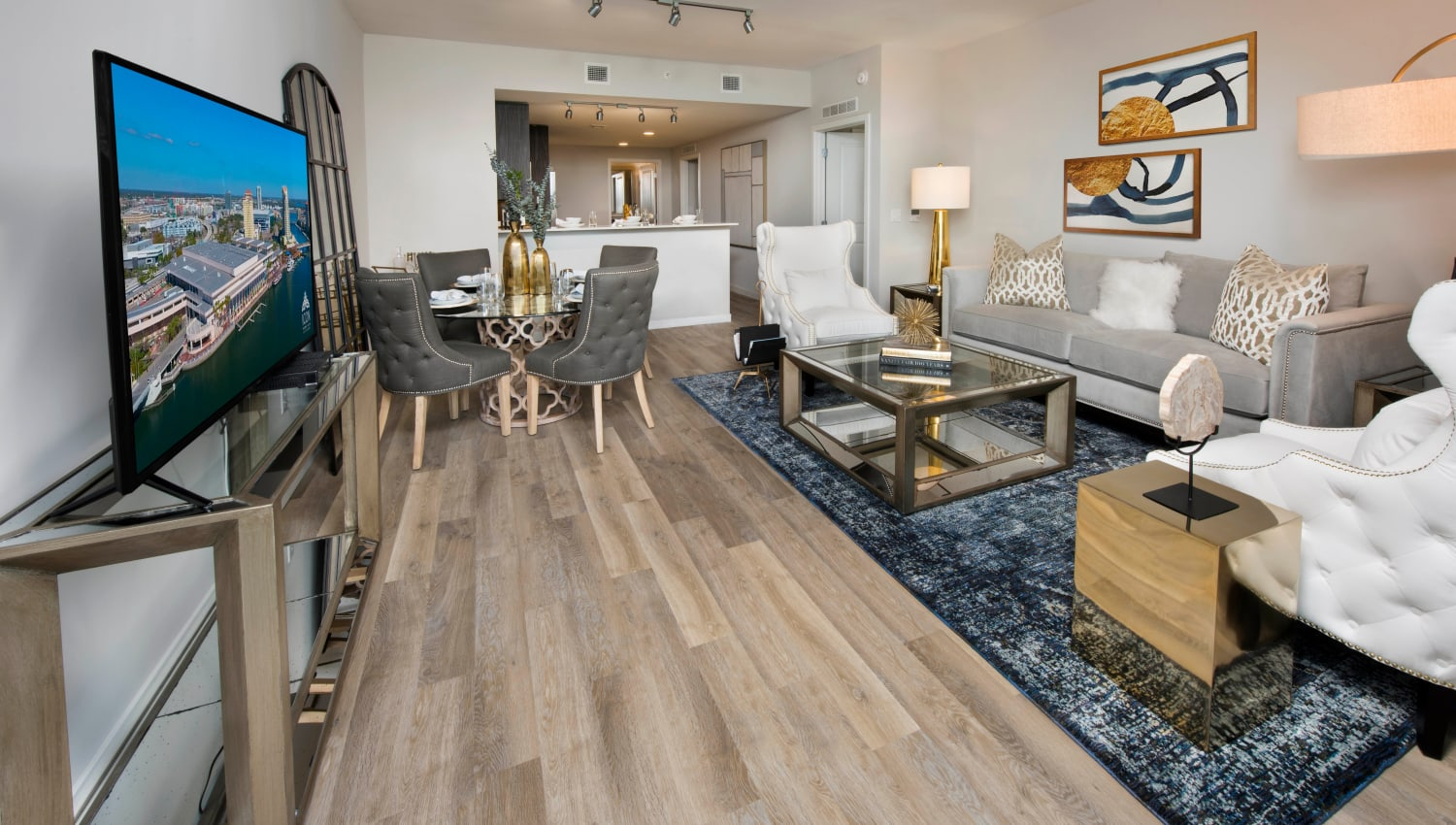 Spacious and well-furnished model home's living area with hardwood floors at Olympus Harbour Island in Tampa, Florida