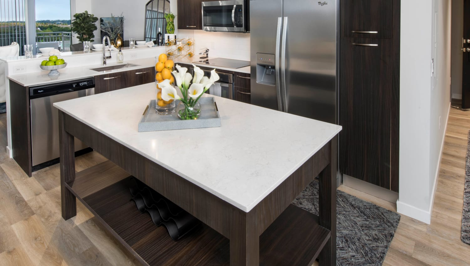 Stainless-steel appliances and an island in a model home's kitchen at Olympus Harbour Island in Tampa, Florida