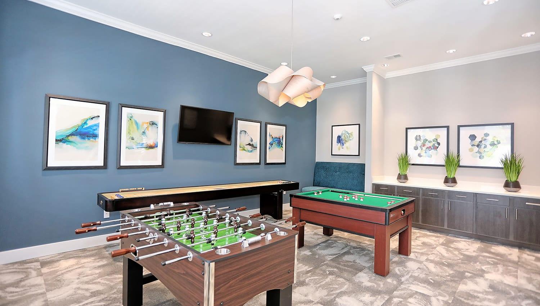 Foosball and tabletop shuffleboard in the game room at The Slate in Savannah, Georgia