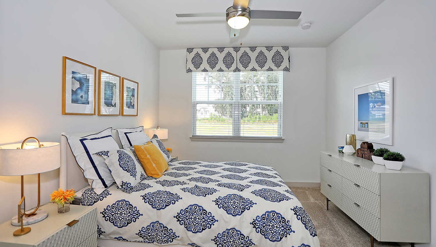Ceiling fan and plush carpeting in a model home's master bedroom at The Slate in Savannah, Georgia