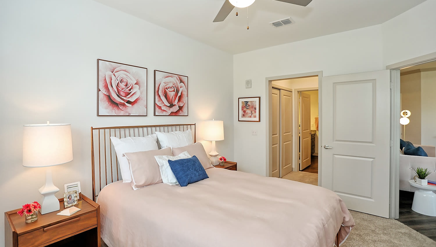 Cheerfully decorated model home's bedroom with a ceiling fan at The Slate in Savannah, Georgia