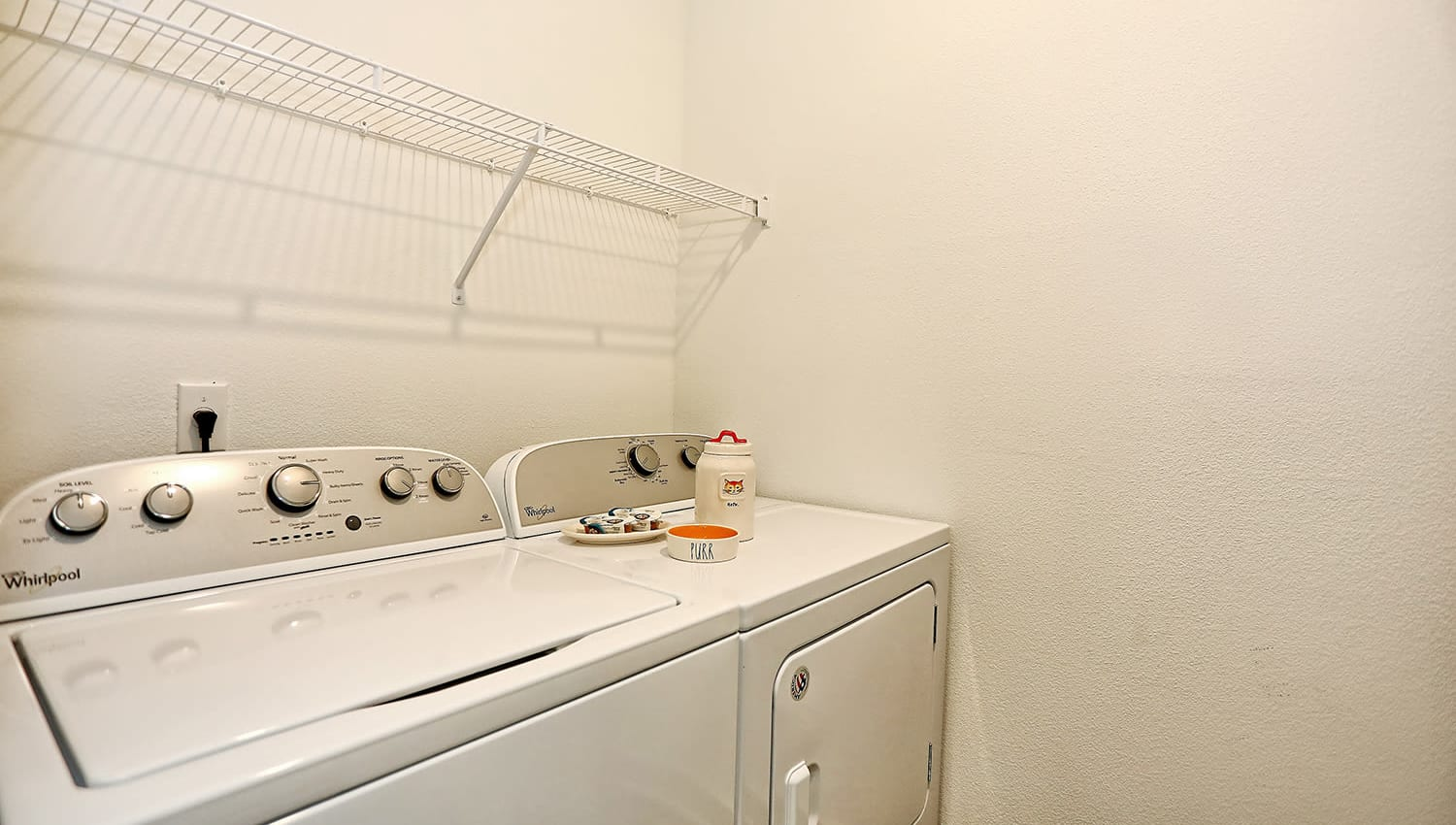 Full-size in-unit washer and dryer in a model apartment at The Slate in Savannah, Georgia