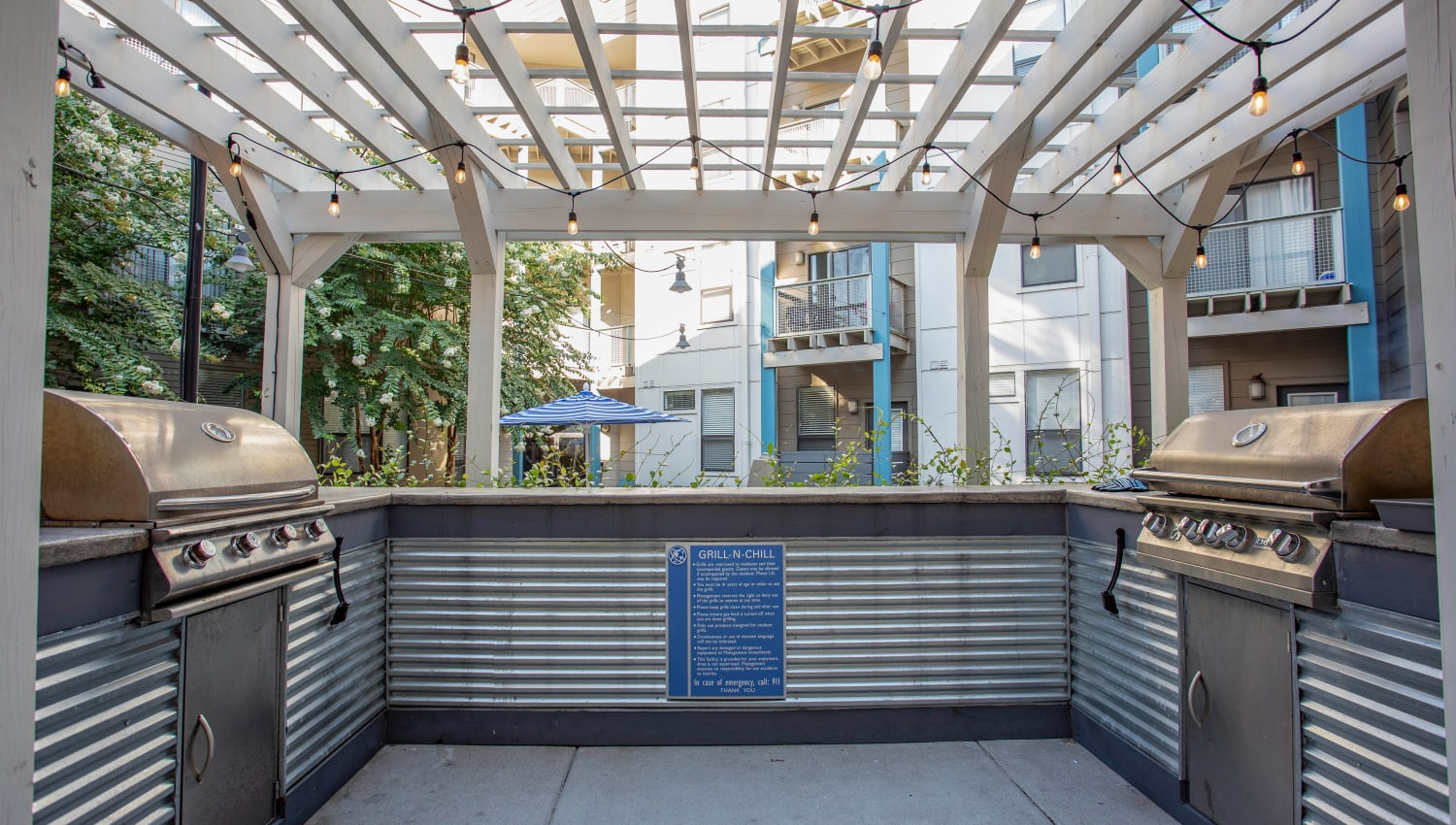 Pergola over the barbecue area with gas grills at Olympus Midtown in Nashville, Tennessee