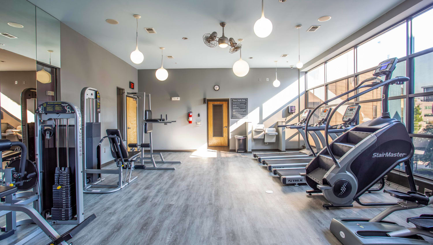 Well-equipped onsite fitness center at Olympus Midtown in Nashville, Tennessee