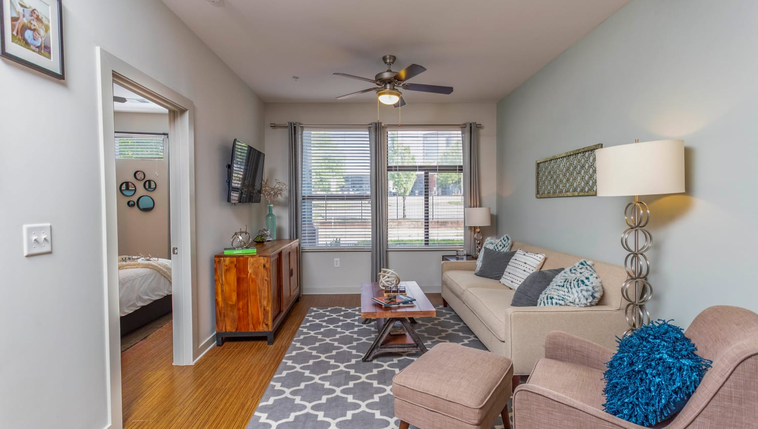 Comfortably furnished living space in a model apartment at Olympus Midtown in Nashville, Tennessee
