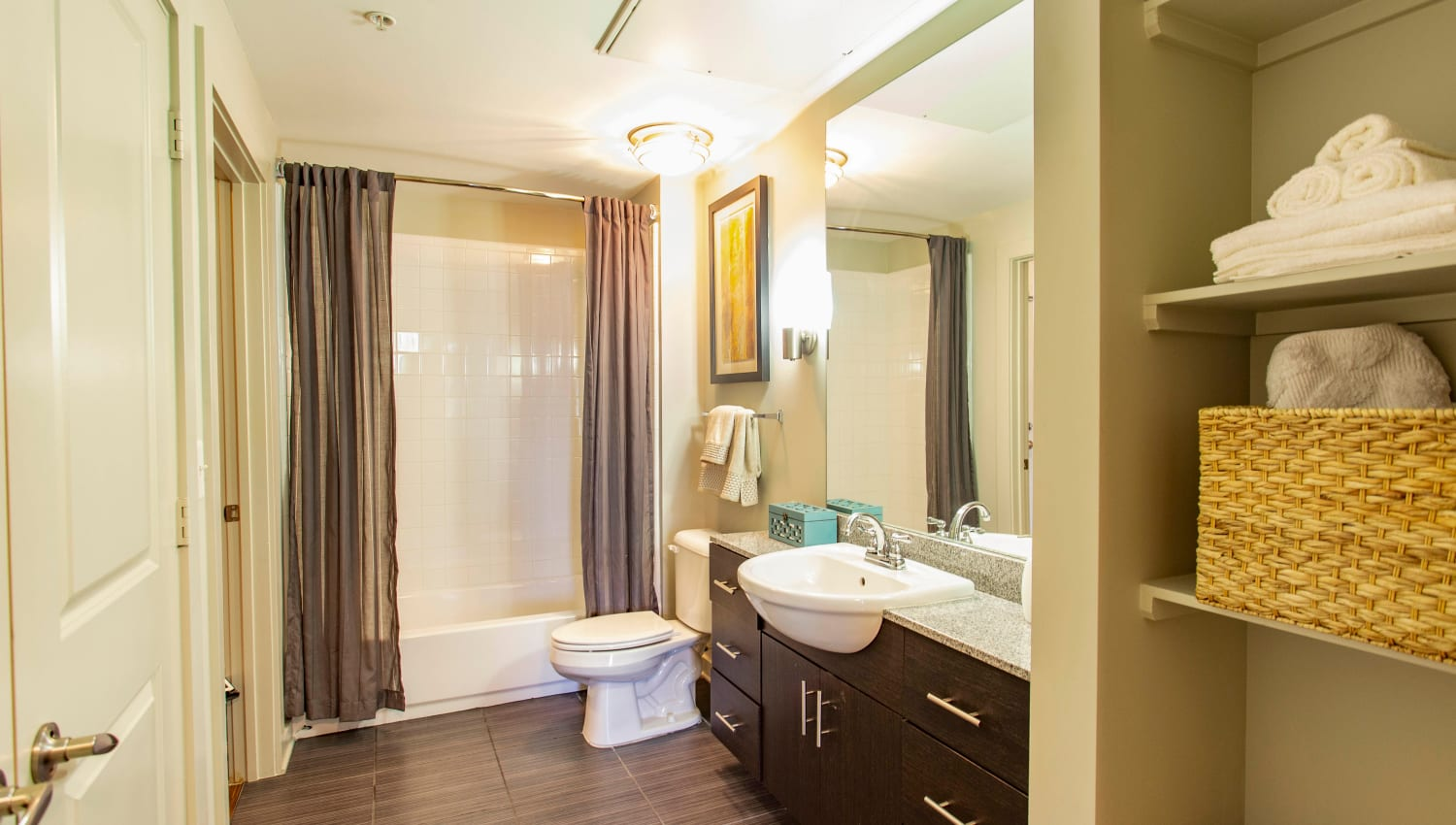Spacious master bathroom with extra storage and a granite countertop at Olympus Midtown in Nashville, Tennessee