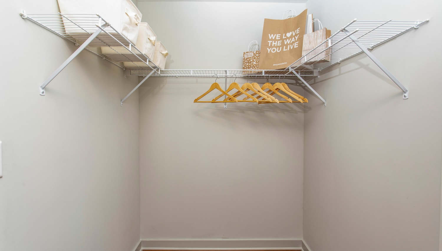 Walk-in closet in a model apartment's bedroom at Olympus Midtown in Nashville, Tennessee