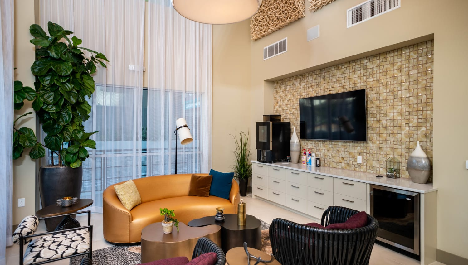 Complimentary coffee service area in the lobby at Fusion Apartments in Irvine, California
