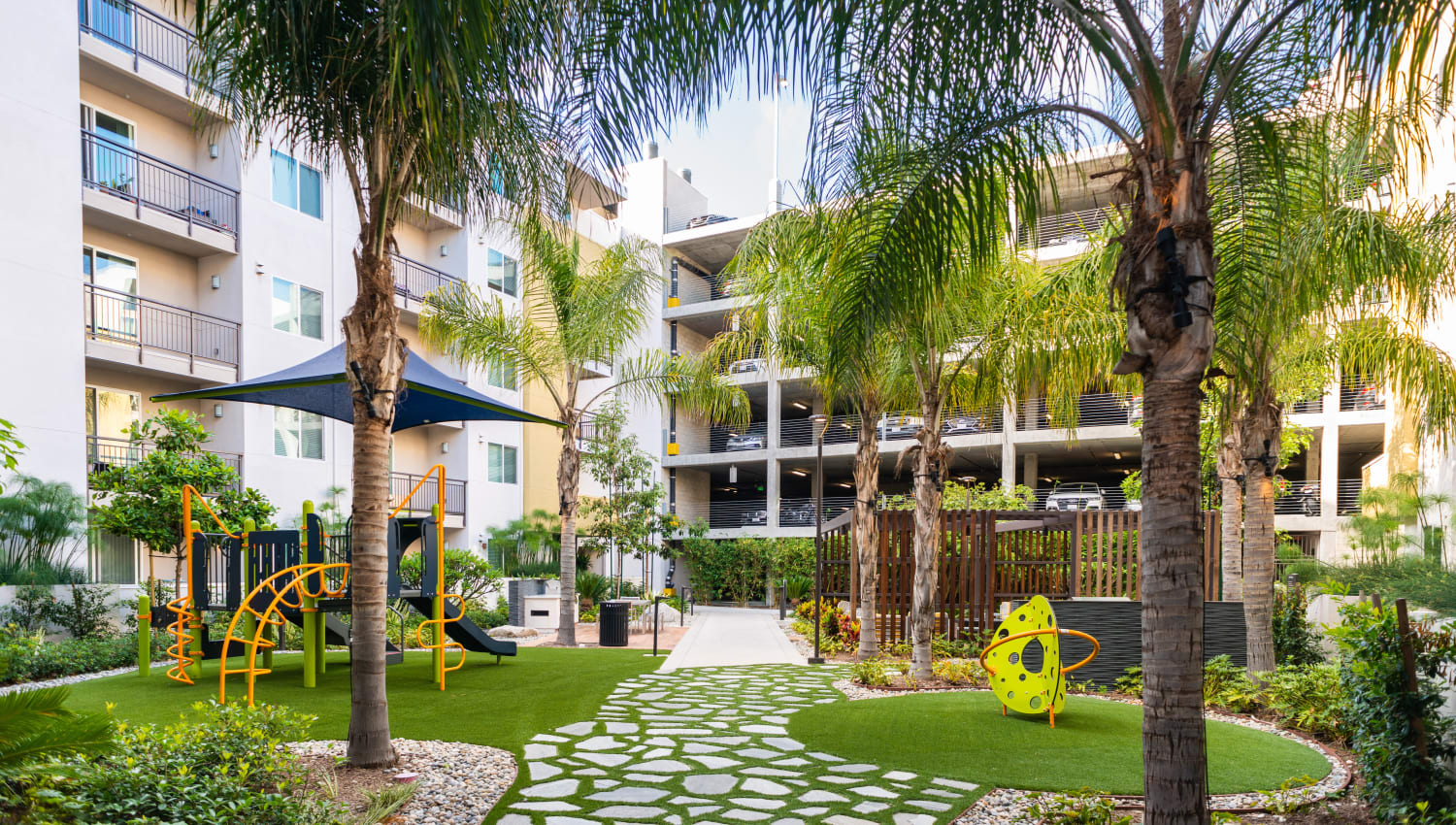 Professionally maintained landscaping at an exterior courtyard at Fusion Apartments in Irvine, California
