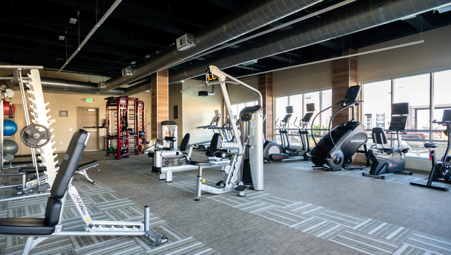 Well-equipped fitness center at Fusion Apartments in Irvine, California