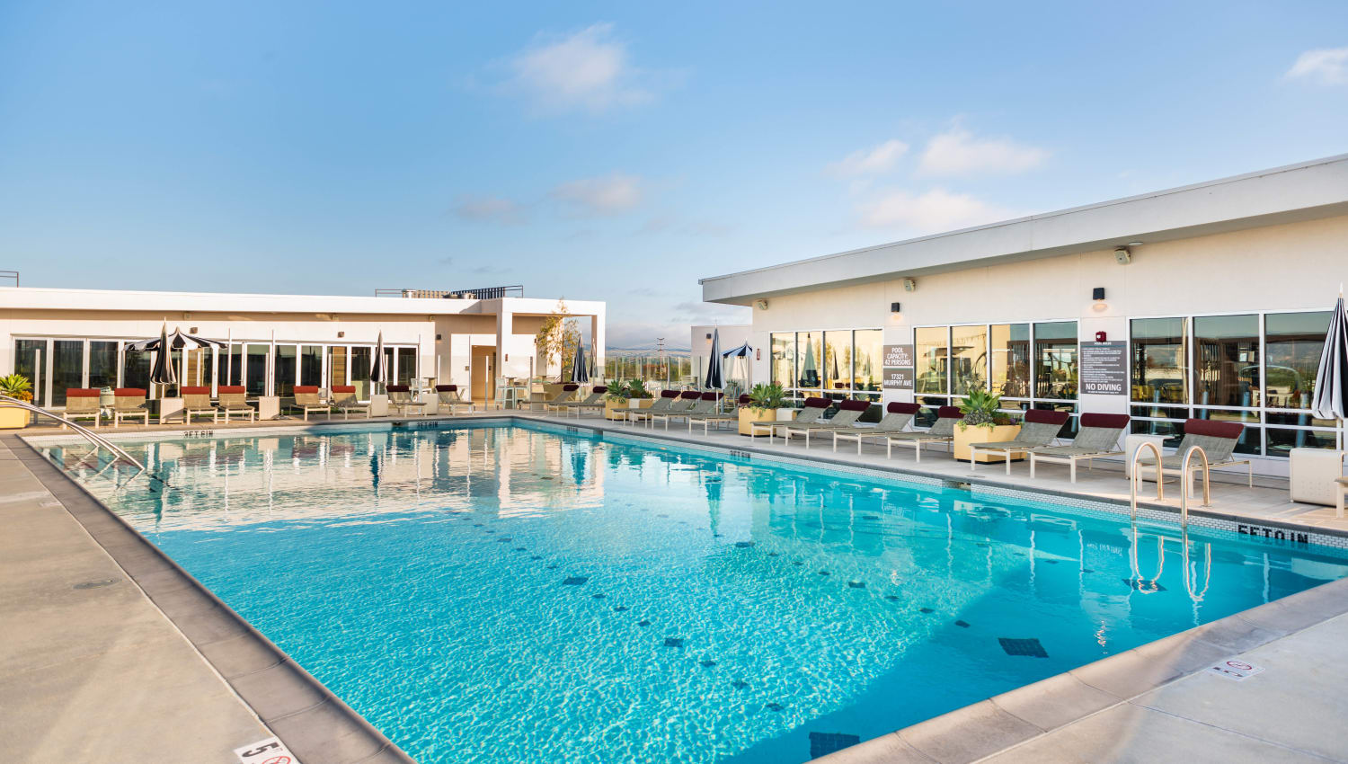 Rooftop resort-style swimming pool with incredible views at Fusion Apartments in Irvine, California