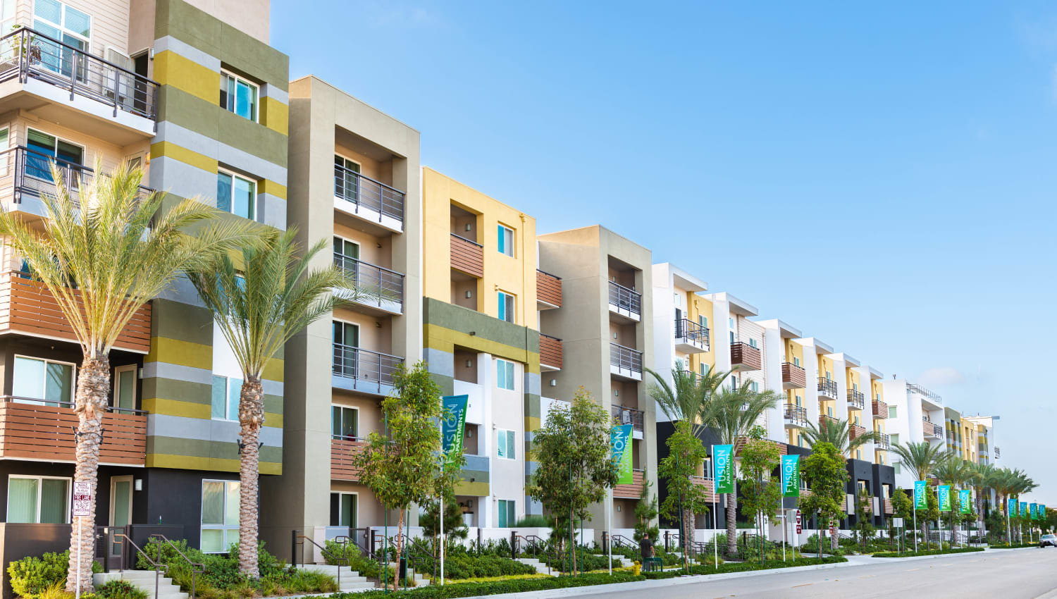 Palm trees outside resident buildings at Fusion Apartments in Irvine, California