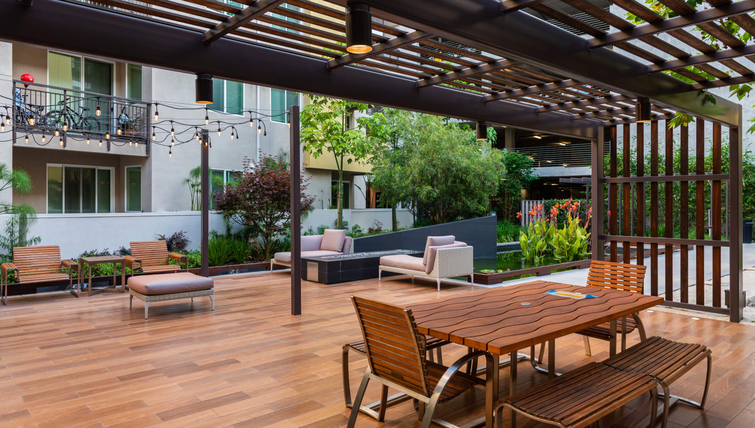 Pergola over a picnic table at one of the common area courtyards at Fusion Apartments in Irvine, California