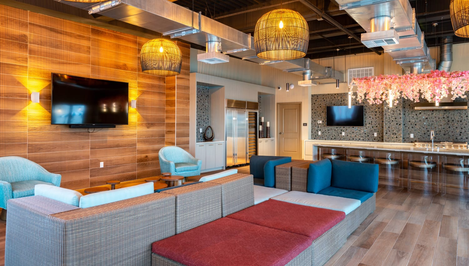 Flatscreen TVs in one of the resident lounge areas at Fusion Apartments in Irvine, California