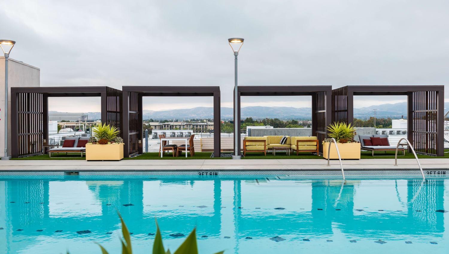 Private cabanas next to the swimming pool at Fusion Apartments in Irvine, California