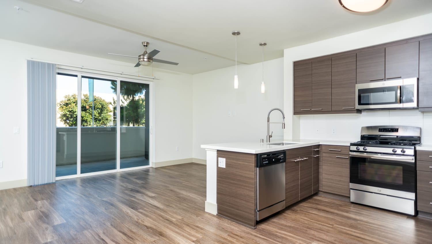 View of the private balcony outside a model home's kitchen at Fusion Apartments in Irvine, California