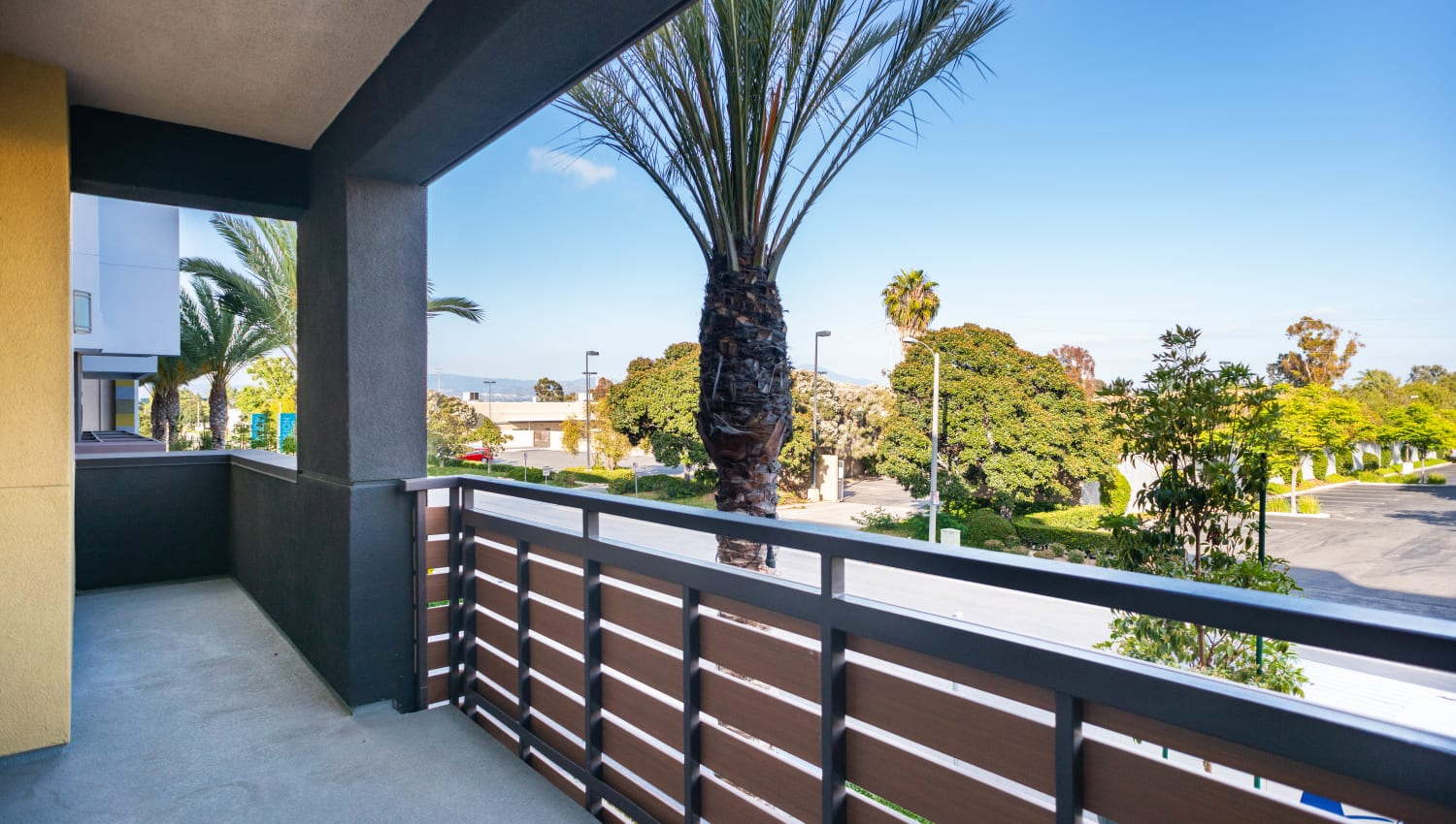 Spacious private balcony outside a model home at Fusion Apartments in Irvine, California