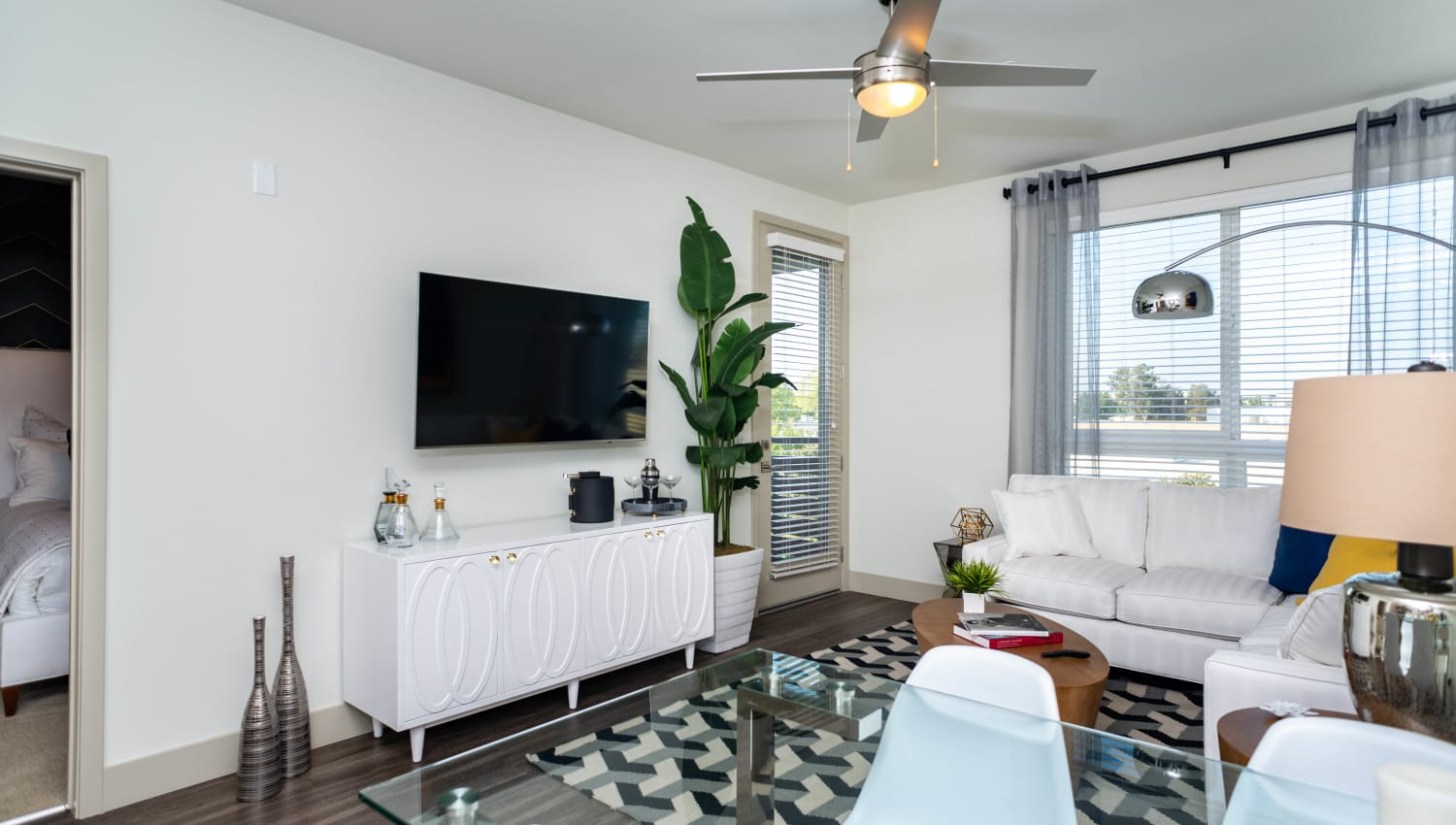 Ceiling fan and modern decor in a model home's living area at Fusion Apartments in Irvine, California