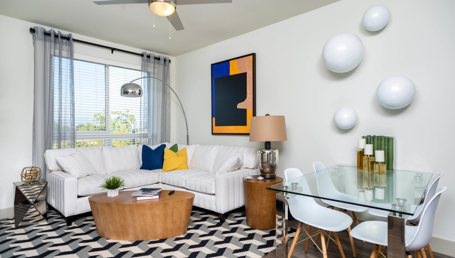 Modern art in the living area of a model apartment at Fusion Apartments in Irvine, California