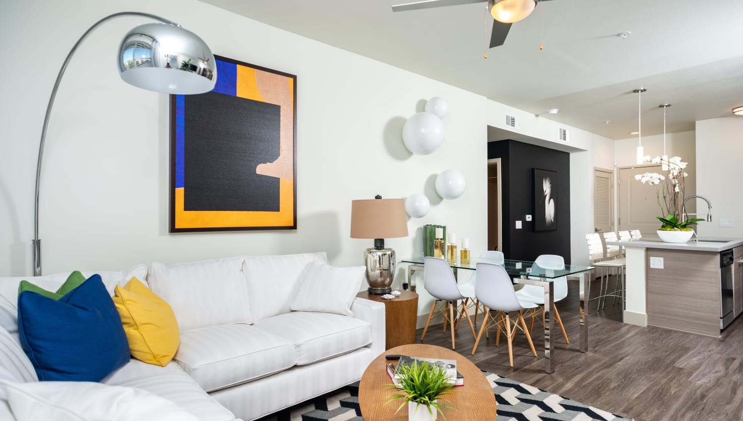 Modern furnishings and a ceiling fan in a model apartment's living area at Fusion Apartments in Irvine, California