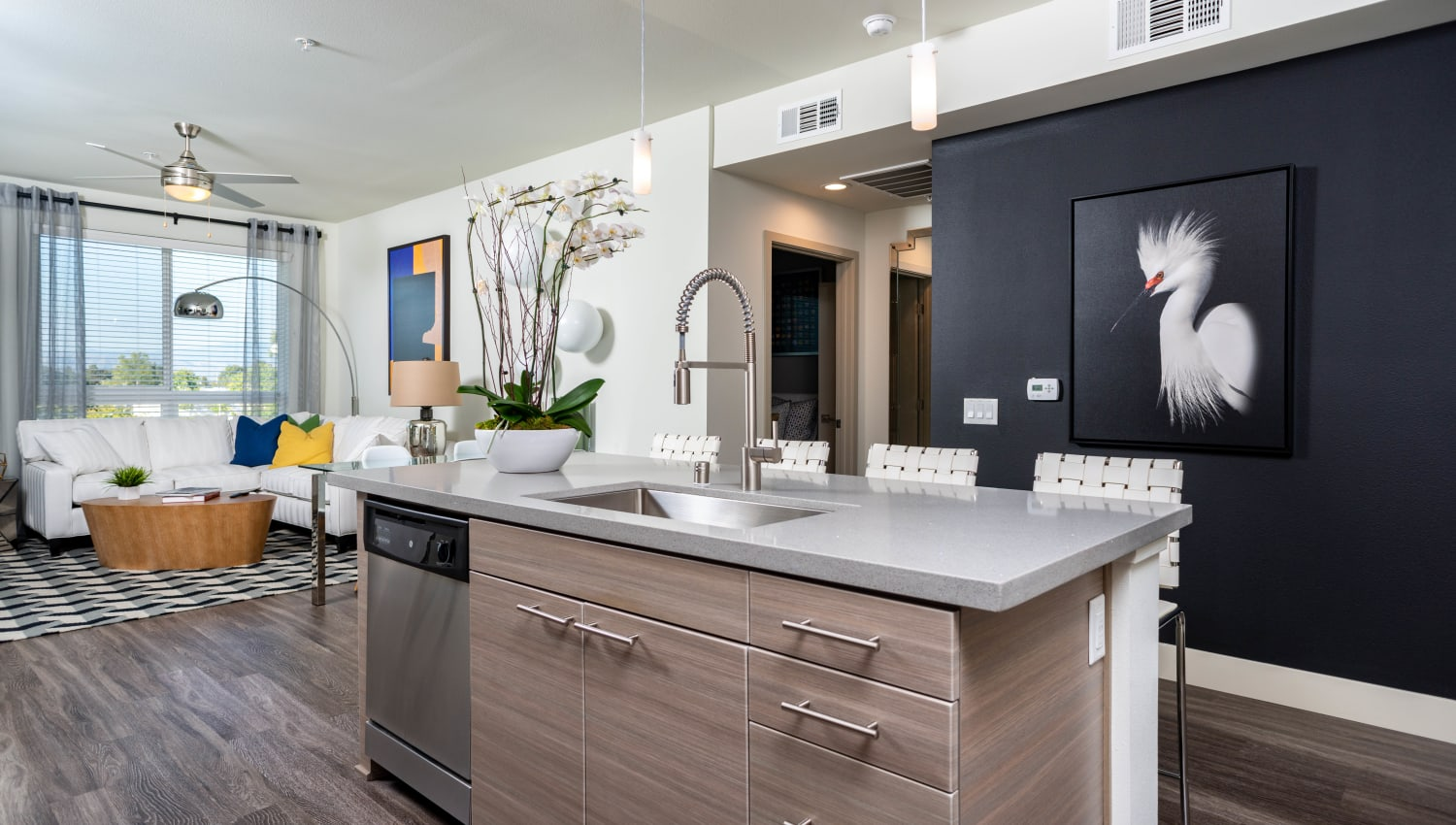View of the living area from a model apartment's kitchen at Fusion Apartments in Irvine, California