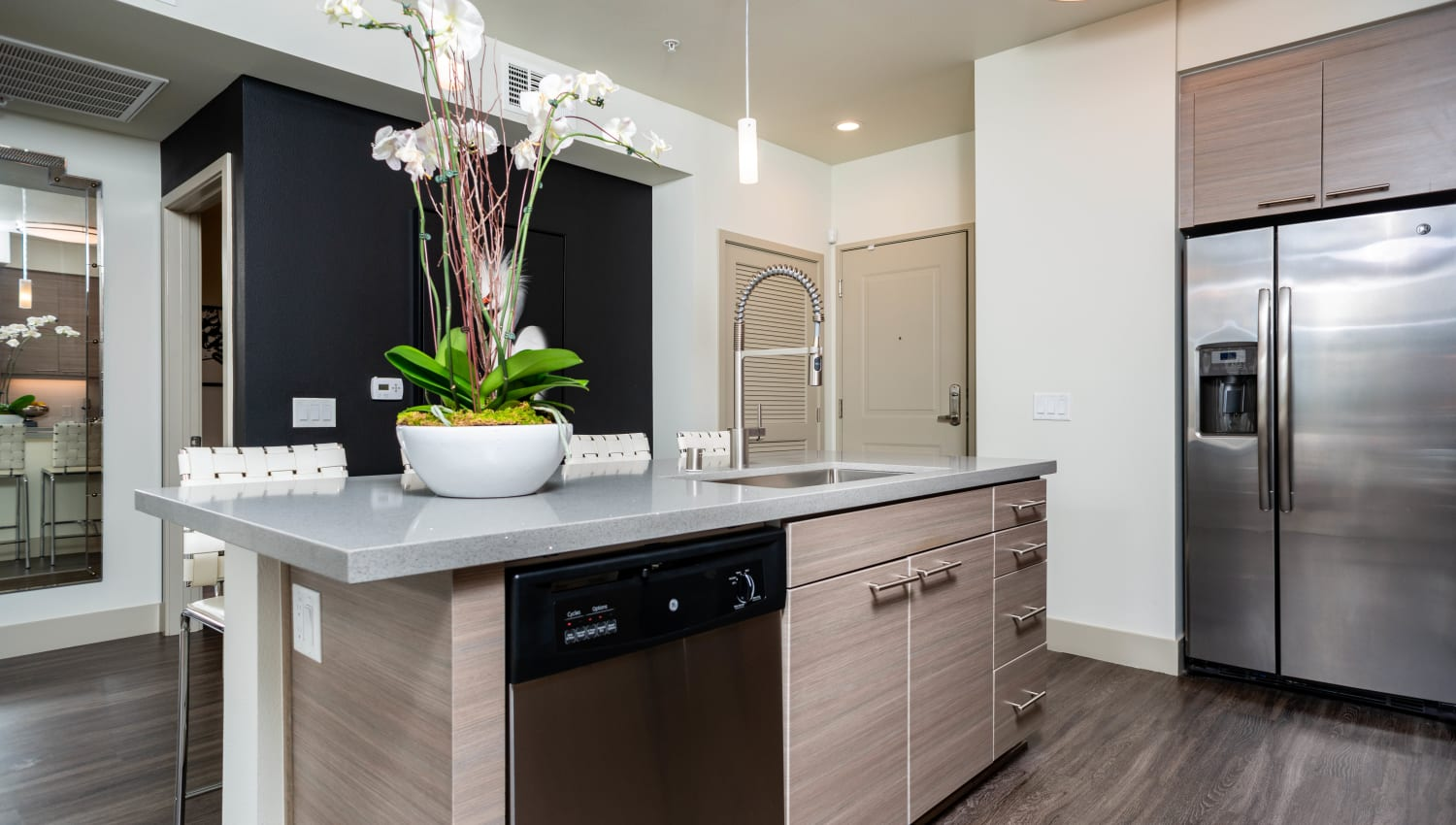Gourmet kitchen with an island in a model apartment at Fusion Apartments in Irvine, California