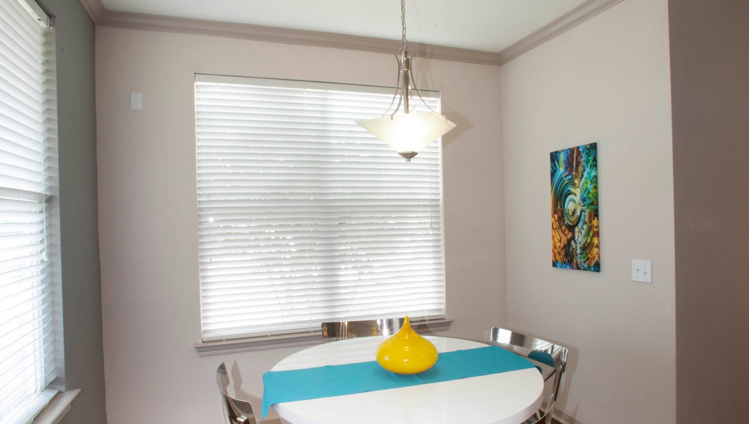 Custom lighting above the breakfast nook in a model home at Olympus Katy Ranch in Katy, Texas