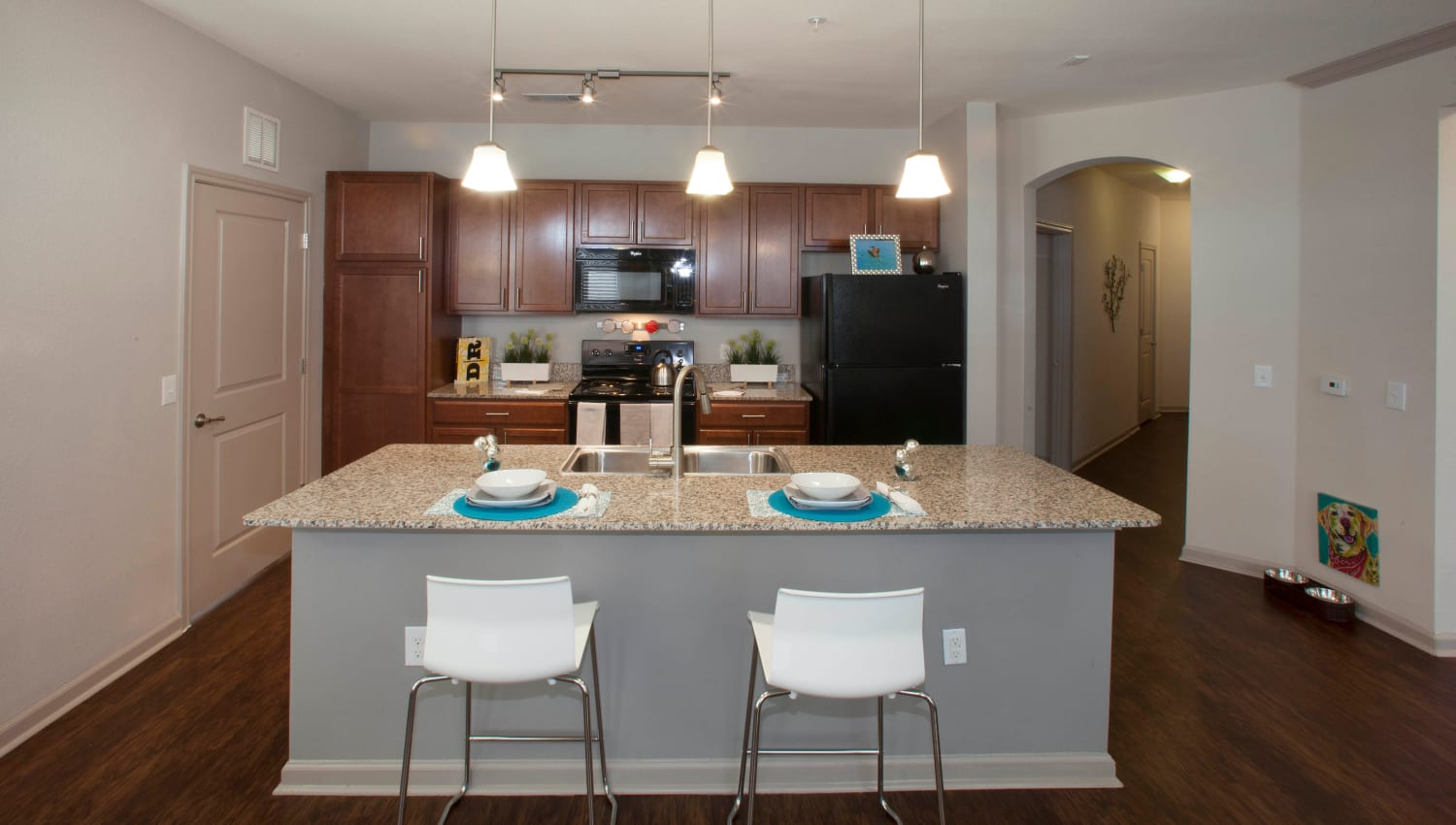 Gourmet kitchen with granite countertops in a model apartment at Olympus Katy Ranch in Katy, Texas