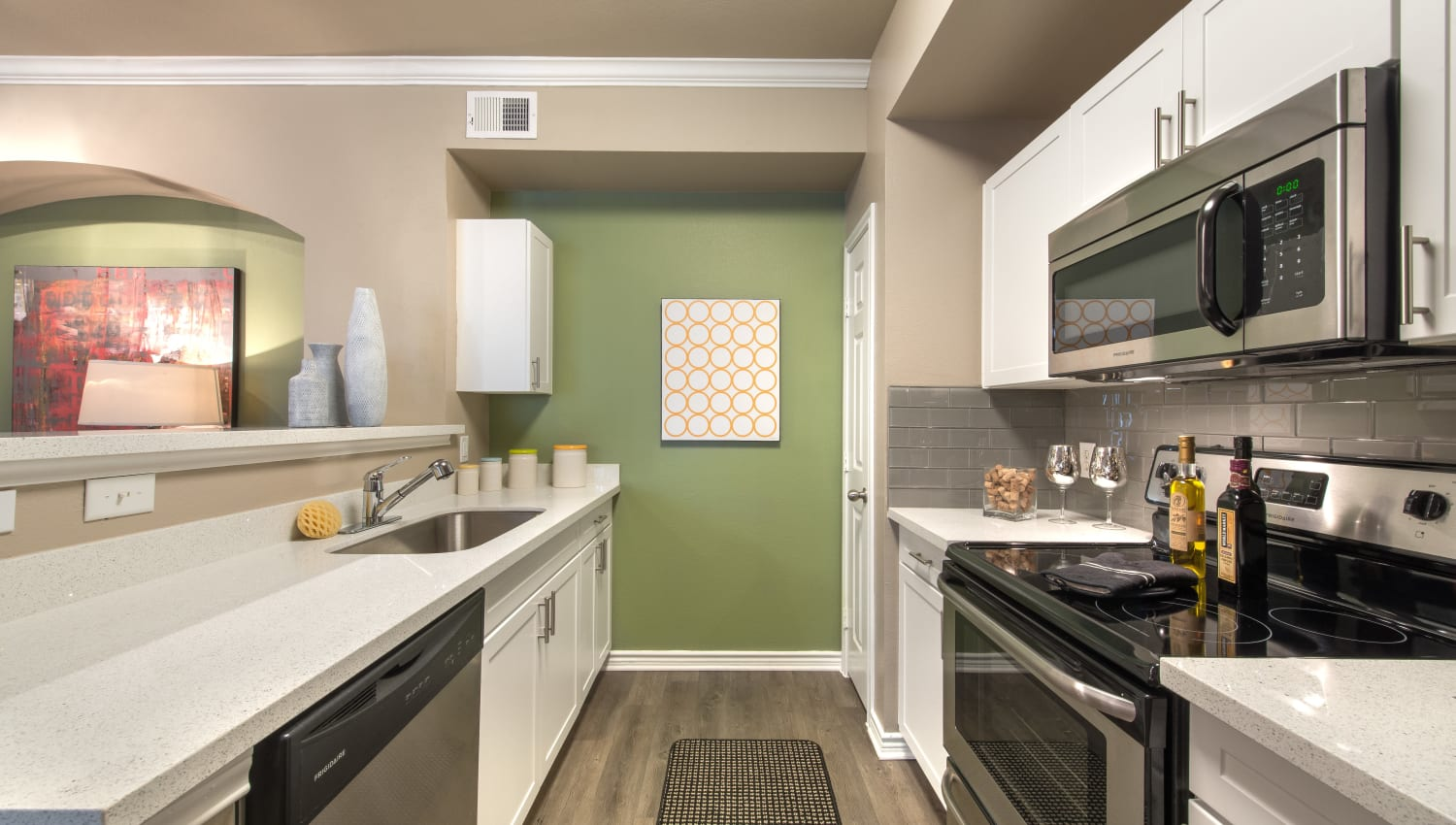 Kitchen featuring modern amenities and ample countertop space at Olympus 7th Street Station in Fort Worth, Texas