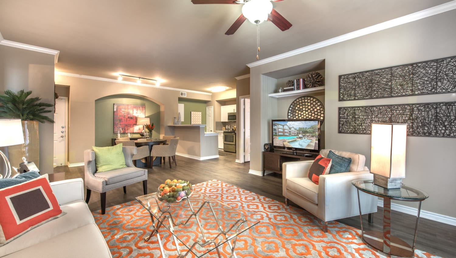 Spacious living room featuring area rugs and fine furnishings in an apartment at Olympus 7th Street Station in Fort Worth, Texas