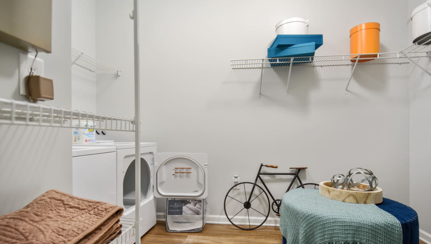 Spacious laundry room with shelving for storage in a model apartment at Ellington Midtown in Atlanta, Georgia