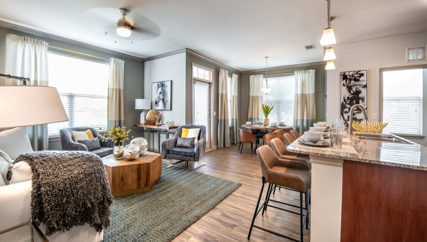 Model living room and kitchen with style at Olympus Katy Ranch in Katy, Texas