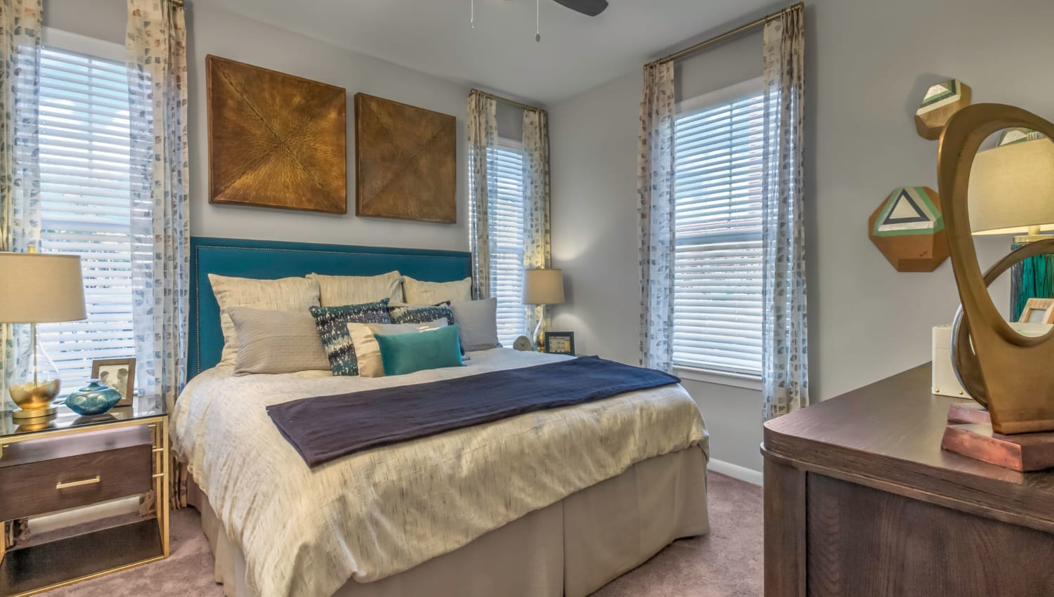 Spacious bedroom with lots of windows at The Palmer in Charlotte, North Carolina