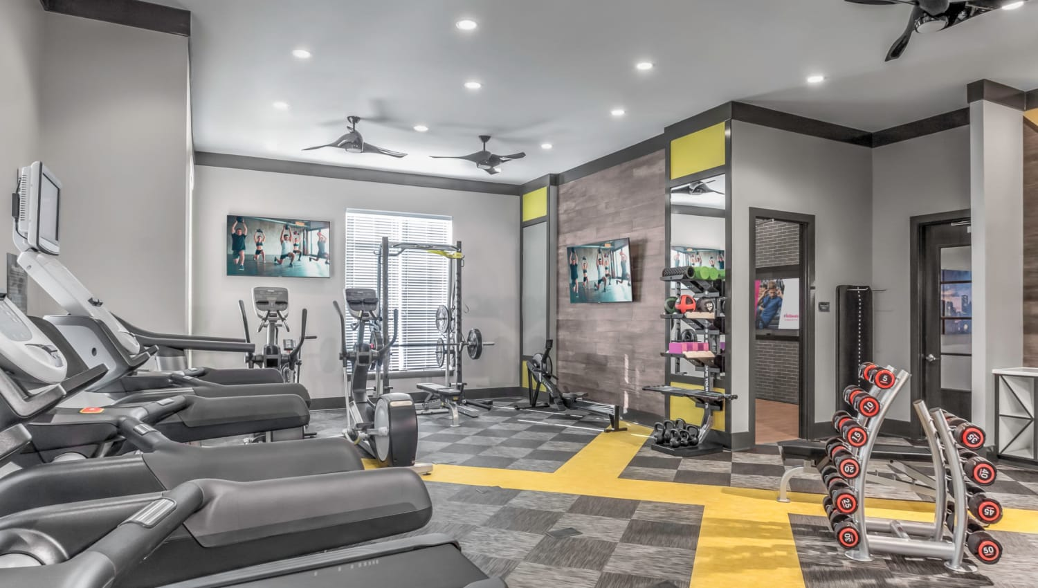 Fitness center with a weight station at The Palmer in Charlotte, North Carolina