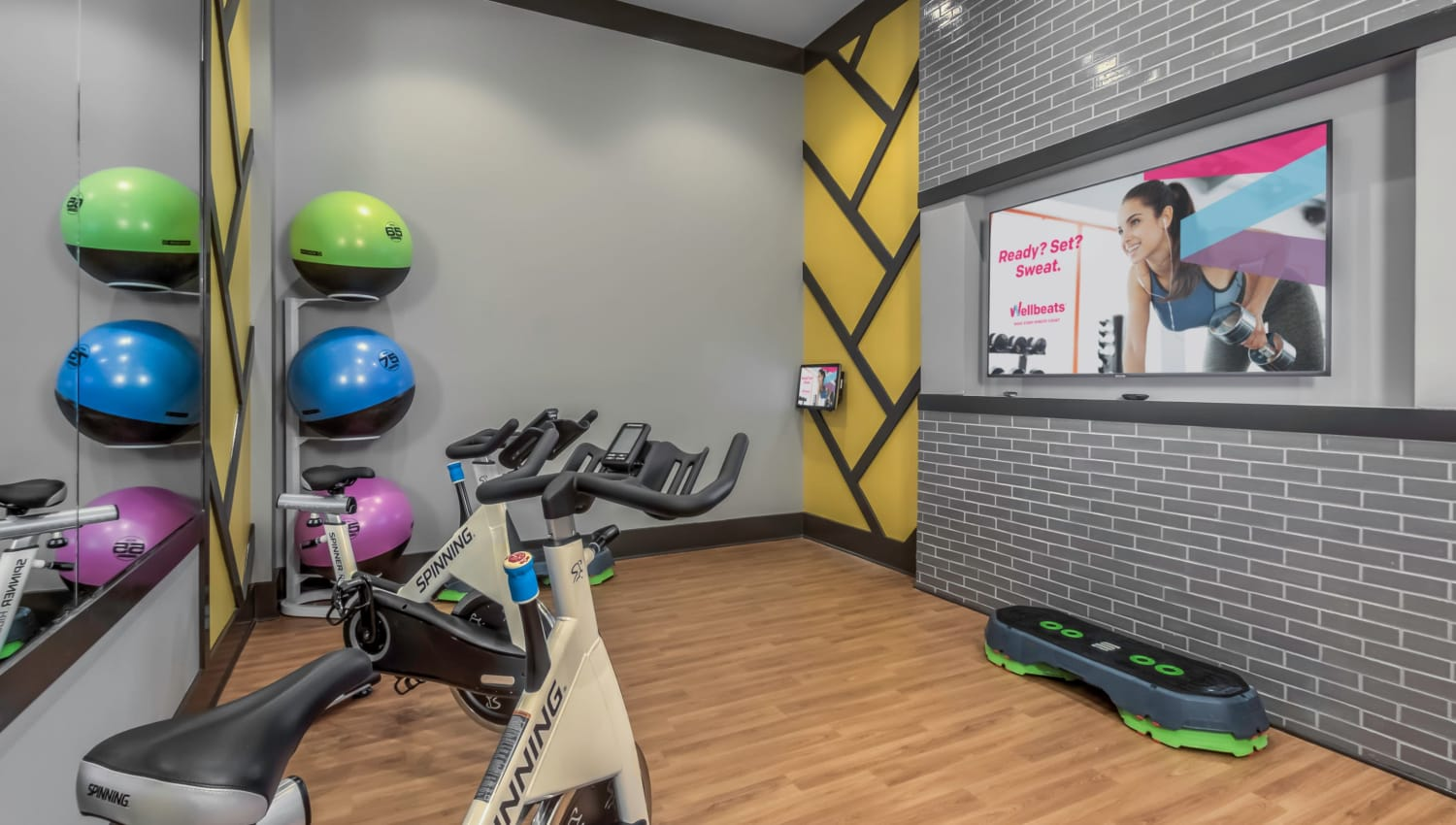 Resident fitness center with a private room with a spin bike at The Palmer in Charlotte, North Carolina