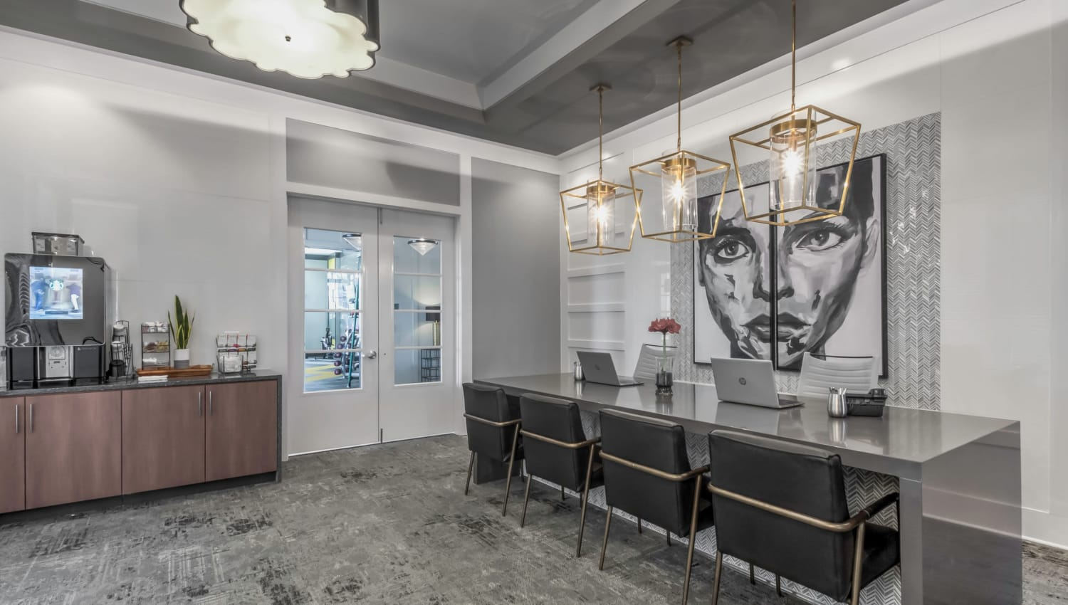 Leasing center with a coffee station and a large table at The Palmer in Charlotte, North Carolina