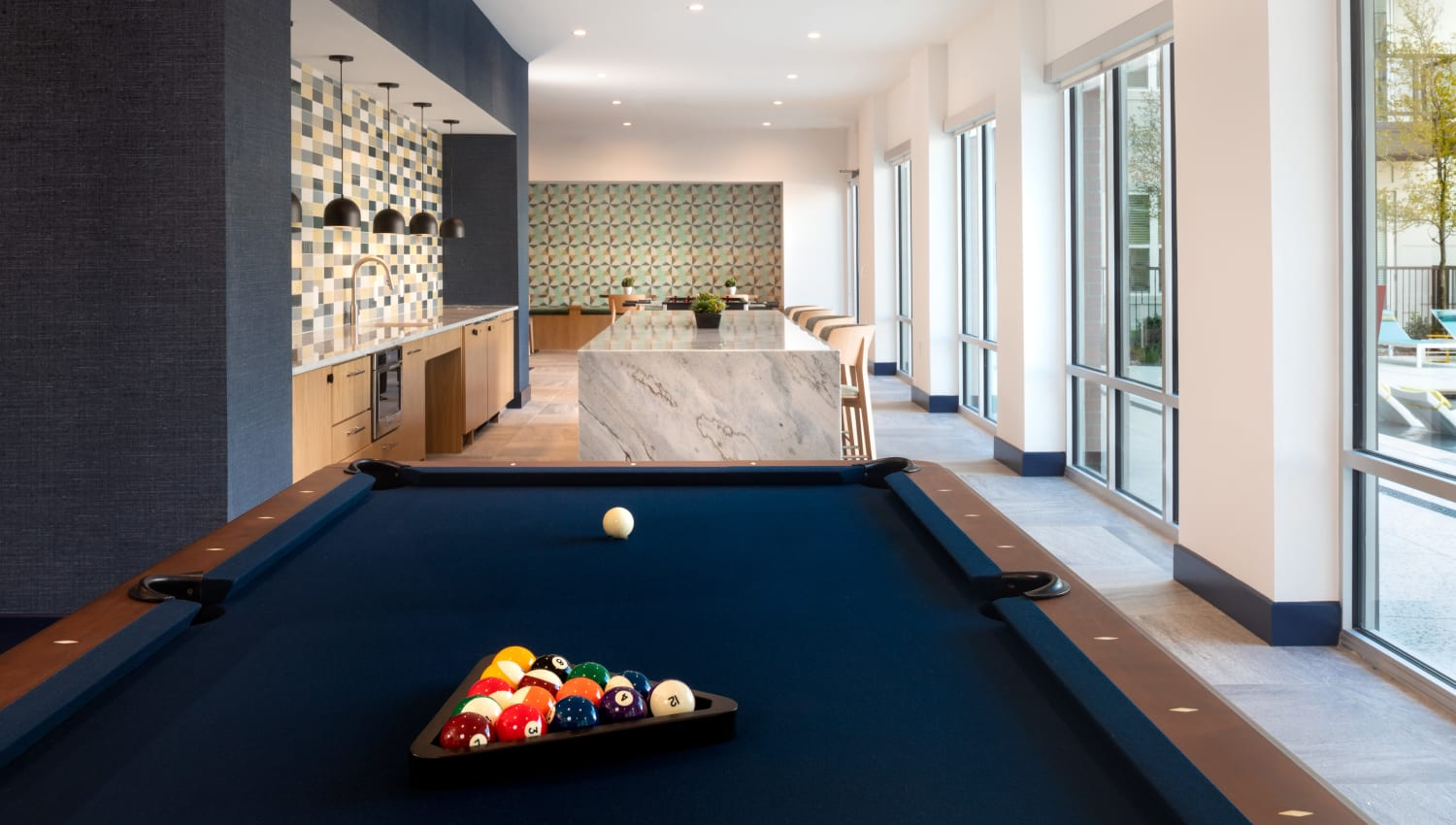 Recreation room with pool table and shuffle board at Olympus on Broadway in Carrollton, TX
