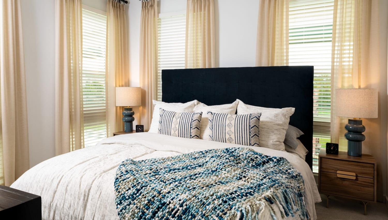 Cozy bedroom at Olympus on Broadway in Carrollton, TX
